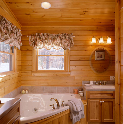 Large soaking tub in Ward Log Home Bathroom