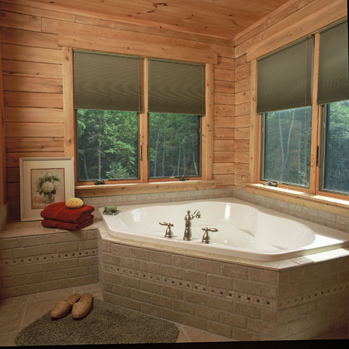 Ward's Norfolk bathroom with large corner tub with gliding windows
