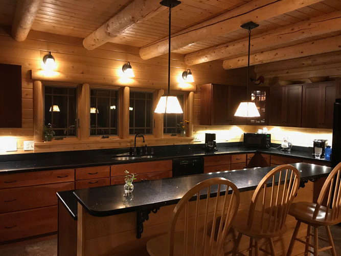 Madison Log Home Kitchen at night
