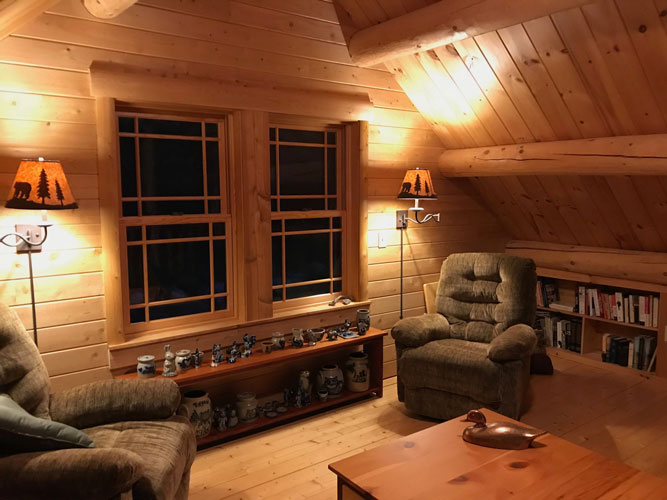 Madison Log Home Loft at night
