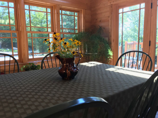 Dining table in Madison Log Home
