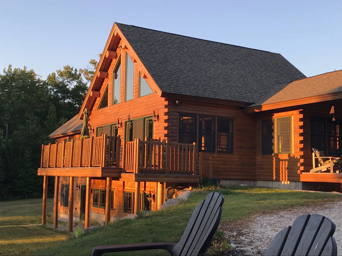 Madison Log Home during sunset