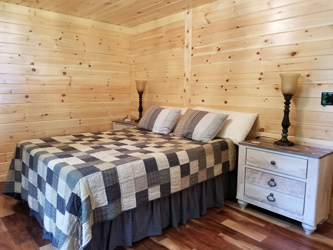 Full bedroom of Musquash log cabin