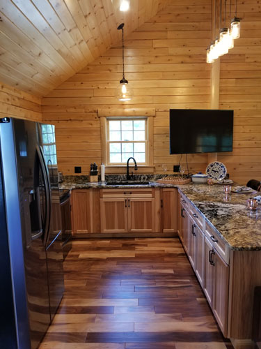 Open kitchen of Musquash log cabin