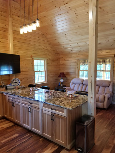 Kitchen with granite countertop of Musquash log cabin