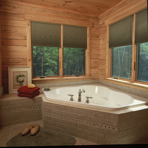 Bathroom with corner tub and double windows