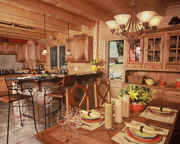 Dining and kitchen with exposed beams