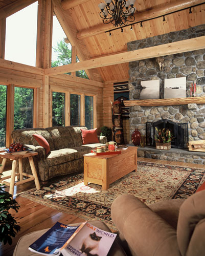 Great room with large fireplace and purlins