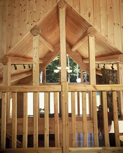 Loft area with cedar rail and purlins