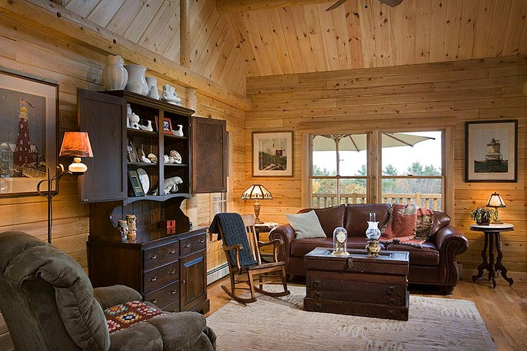 Sitting area in log home with leather couch