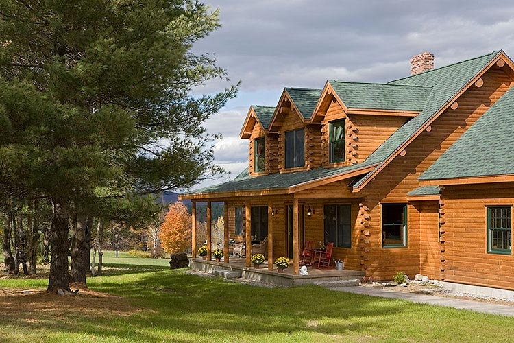 Log home exterior with 3 gable dormers in loft