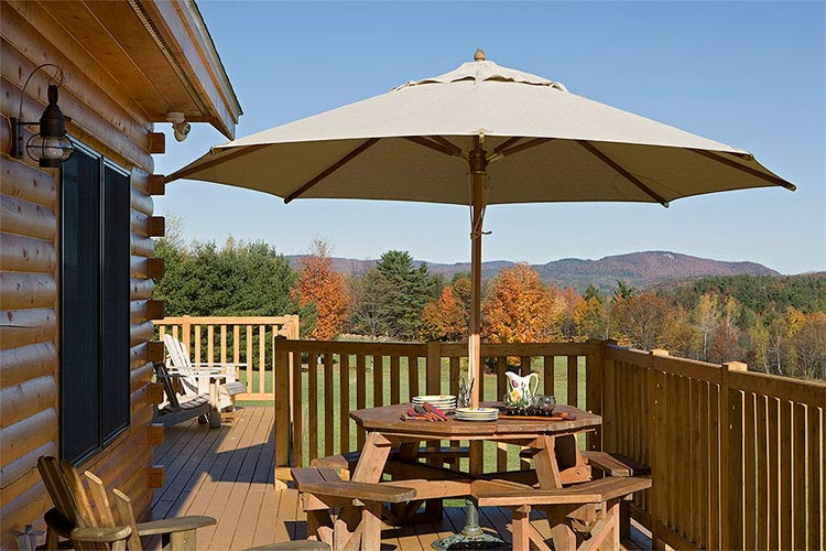 Large deck of log home looking at mountain scenery