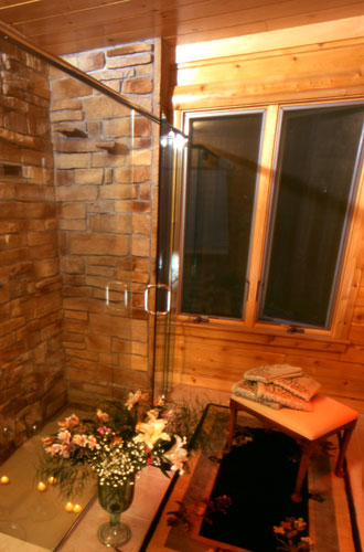 Glass shower in log home bathroom