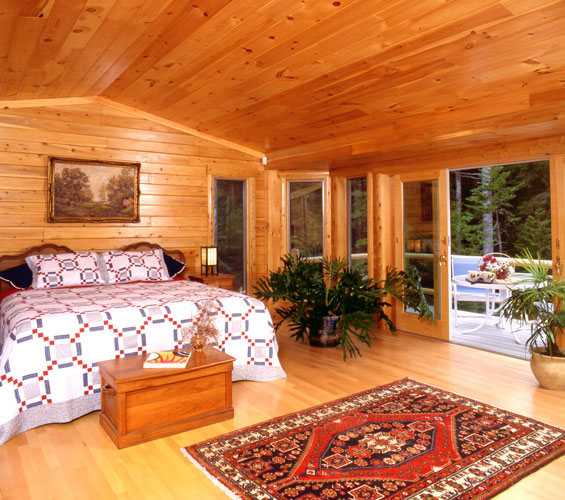Large bedroom with sliding doors to deck