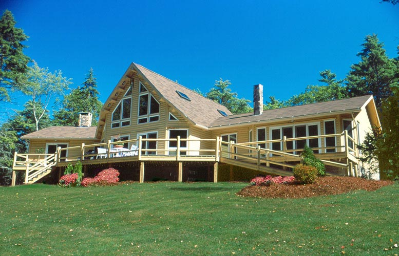 Exterior of log home with landscaping