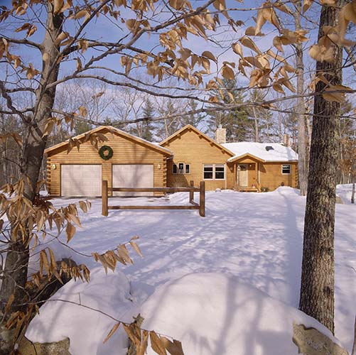 Sebago Lake Log Home Exterior with snow
