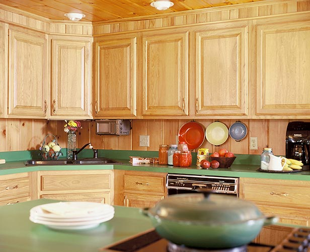 Kitchen cabinets with green counter-top