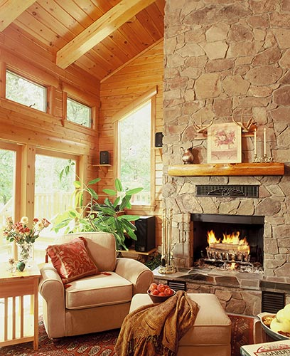 Cozy fireplace and beige chairs